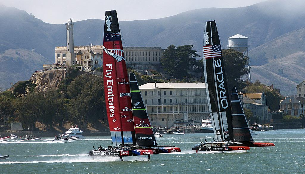 Oracle and Emirates Team New Zealand race past Alcatraz Island.